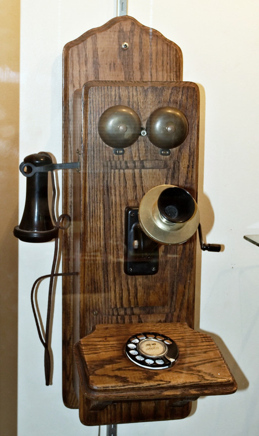 An early model wall mounted telephone, in the Champaign County Historical Museum, Champaign, IL