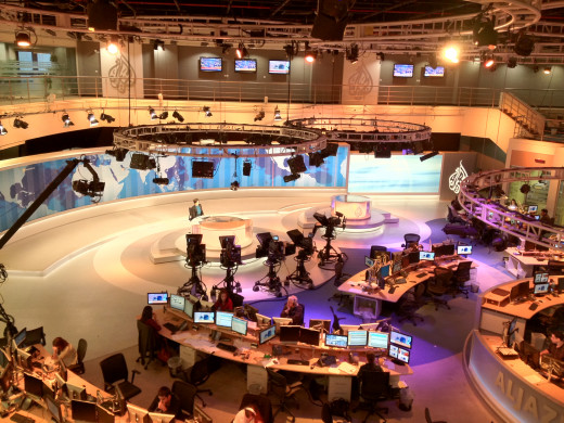 Al Jazeera TV English Newsdesk. Photo from balcony overlooking main television studio towards presenter's desk in the Doha headquarters.