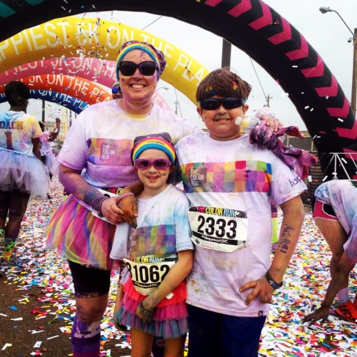 The kids and I covered in color standing in the confetti at the finish line.