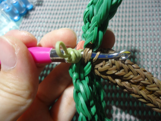 Insert your hook through the leaves' cap band as well as the trunk to join the two parts together.