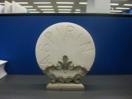 A giant aspirin tablet on display.