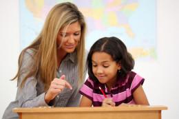 Elementary Teacher helping Student