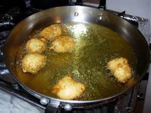 Pan frying croutons.