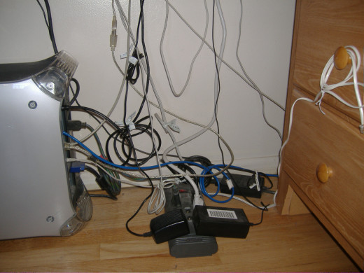 Even a very simple home computer setup can turn into a rats' nest of wires and wall warts.
