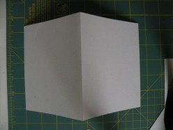 White heavy-weight cardstock folded in half for a card base