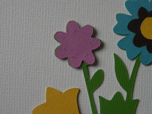 Adhere small purple daisy