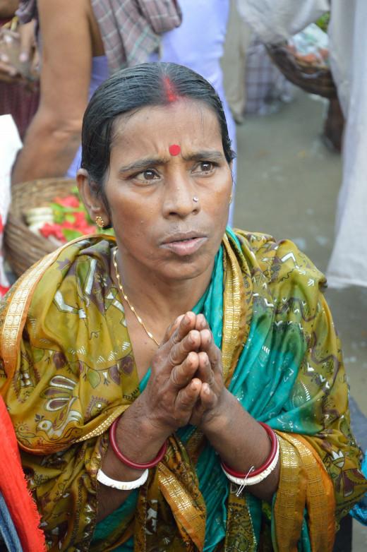 Tarpini- An Hindu woman performing Tarpan in Kolkata on Mahalaya day.