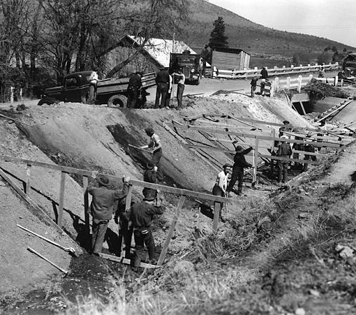 CCC workers prepare a drainage canal in Oregon for fine grading before concrete is poured. Most CCC projects were in the west, which had vast undeveloped park lands.