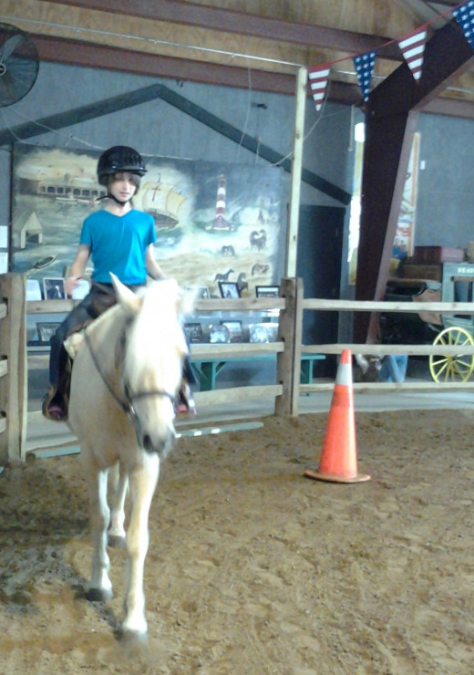 "My daughter riding ""Teaguer"" during a lesson at the Chincoteague Pony Centre."