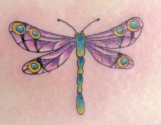 A colorful dragonfly tattoo.