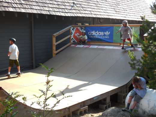 Groms practicing on a half pipe.