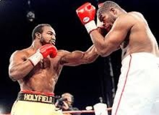 Evander Holyfield, right, beat Holyfield in their second bout to become a two time heavyweight champion.