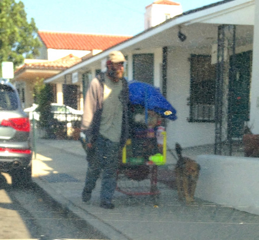 Many homeless are constantly on the move with their large over-stuffed carts and an occasional animal companion.