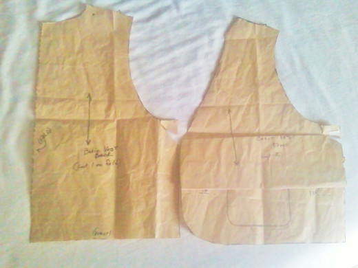 Here I've adjusted the vest front and back pattern pieces for length. Note the cut for the back (left) lined up with the original pattern's waistline. The front, however, required a fold just below the armhole and parallel to the  bottom edge