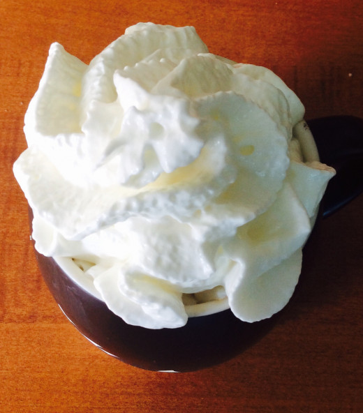 Whipped cream on latte