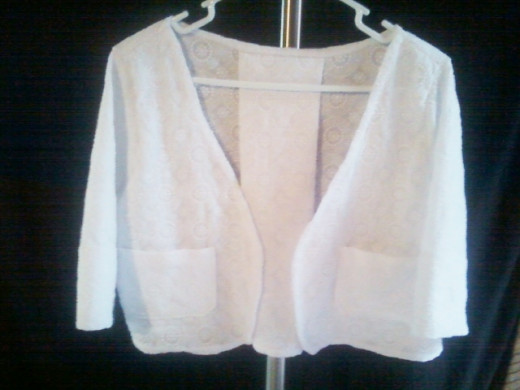 The finished bolero vest with sleeves unrolled.