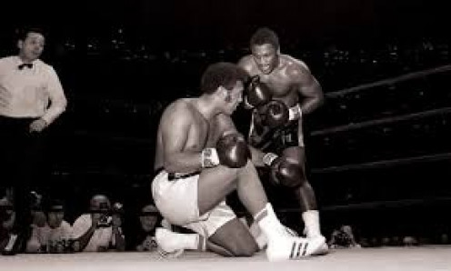 Joe Frazier knocked out Jimmy Ellis in three rounds to become heavyweight champion of the world.