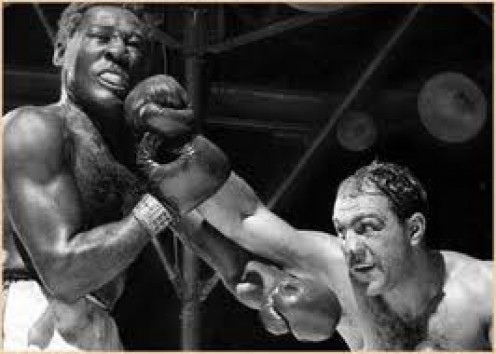 Rocky Marciano knocked Ezzard Charles down twice in the 8th round and the second time was for the count.