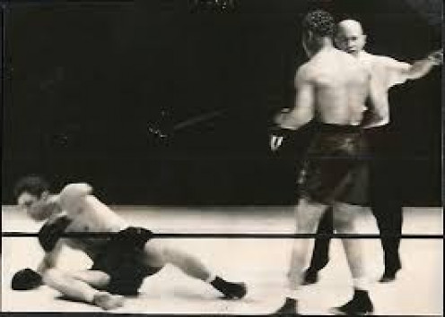 Joe Louis flattened James Braddock in the 8th round to win the heavyweight championship.