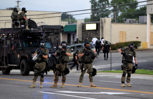 The local police department's SWAT force marches down the street in Ferguson, Missouri during the Michael Brown protests.