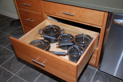 Cherry Cabinets with pull out drawers.