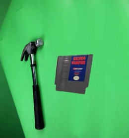 The US release of Silver Surfer came with a hammer. After playing for 30 minutes, the hammer was used to destroy the cartridge forever due to frustration. It was a bold selling strategy, because you had to buy a new game if you wanted to try again.