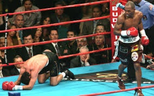 Bernard Hopkins knocked out Oscar De La Hoya with a ninth round body shot in defense of the 160 pound world championship.