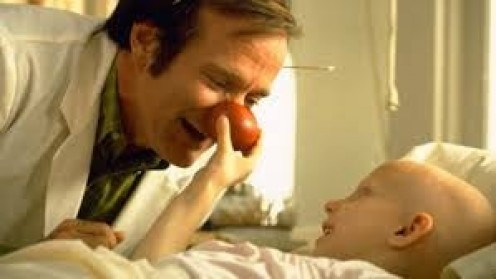 "Robin Williams plays as a goofy Doctor who truly cares about his patients in a true story called ""Patch Adams""."