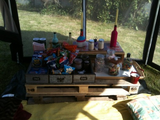 Our food table, complete with drawers, woolly bottles, and lots of food.