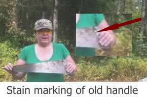 Use the old stain mark of the old handle on the old saw blade as a pattern to  form the extension of the handgrip made from the yellow hacksaw handle.