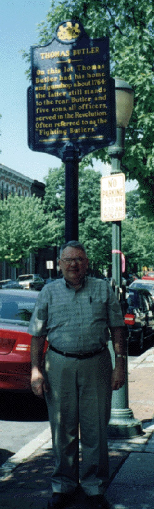 The author, Bill Smith, in front of the Butler sign, in Carlisle, on May 2000 genealogy trip..