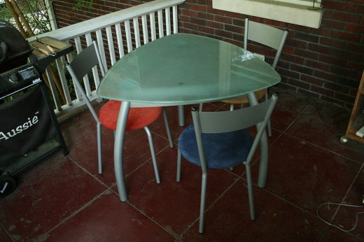 This table has no head and no foot. All sides are equal. Parents of adult children should figure this out, lest their table remain unoccupied by their kids.