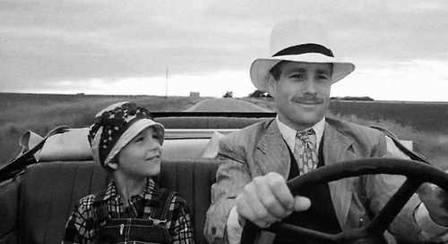 Tatum and Ryan O'Neal traveling the Kansas back roads in Paper Moon