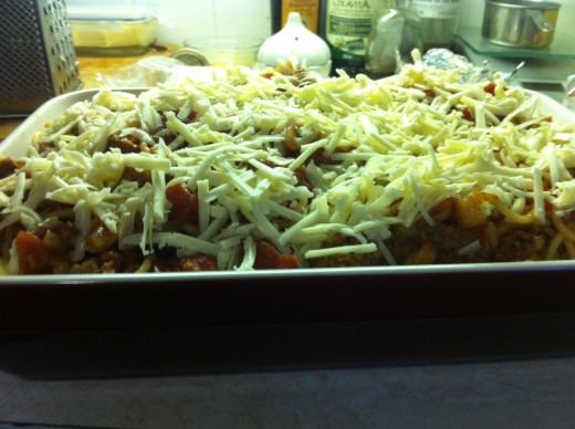 Cheese has been added and the dish is ready to go into the oven.