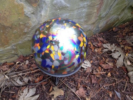 Mosiac gazing ball with ground stake.