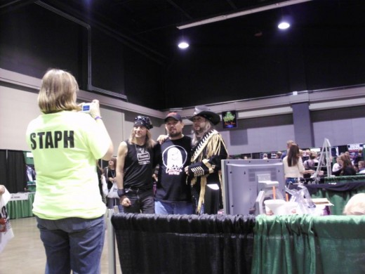 STAPH member assisting with photos for a fan.