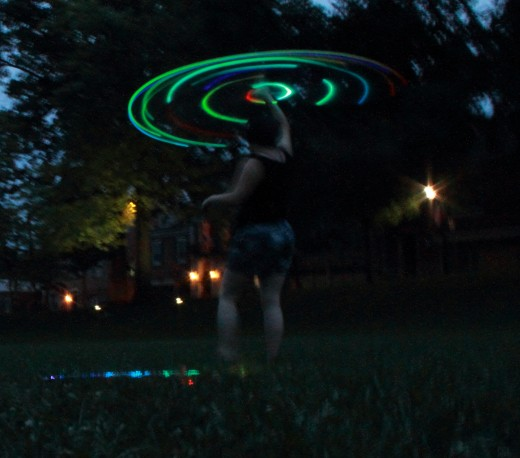 I had a friend take my photo while I spun the hoop over my head.