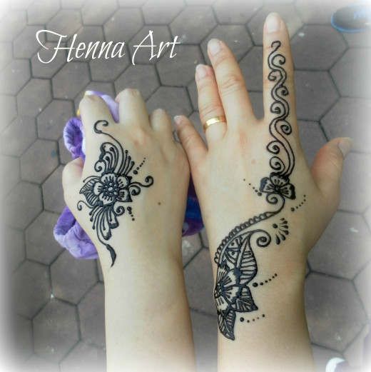 Freshly applied dark coloured henna paste on the skin. The paste is removed when it is dry, to reveal a brownish red stain on the skin.