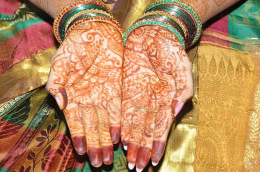 Intricate designs on a bride's hands before her wedding.