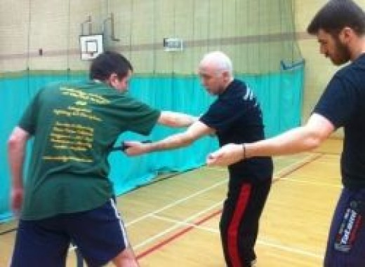 Ollie Batts, professor of Savate Defense, teaching at Cambridge Academy of Martial Arts.