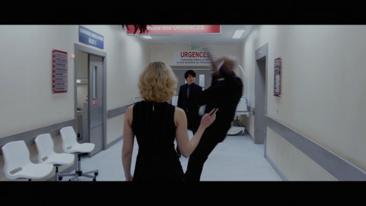 Lucy air lifts and throws a man away with her super brain powers...