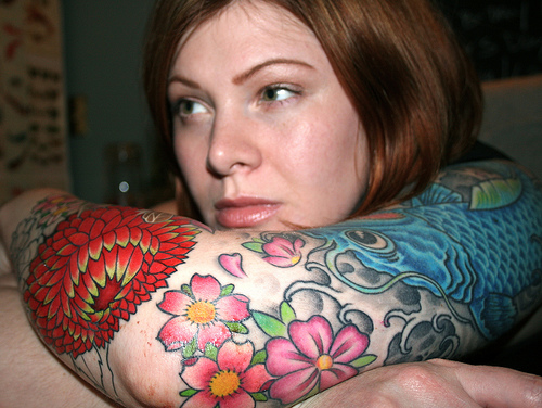 Nice female sleeve tattoo design.  Credit: http://farm4.static.flickr.com/3147/2586760529_e37ac613e7.jpg?v=0