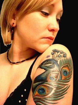 Nice bird quarter sleeve tattoo. Credits: http://farm4.static.flickr.com/3465/3363383884_a5de0c5b9d.jpg?v=0