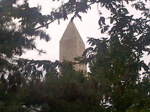Washington Monument through the trees on the southwest side of the National Mall - late summer.