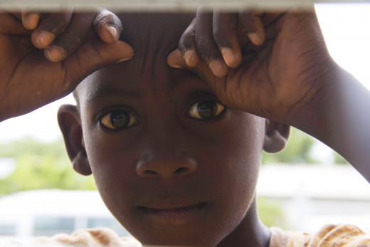 A child looks in at a free medical clinic being offered in the school building.