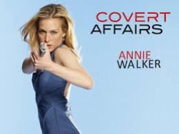 Annie in a blue dress is ready to battle against the bad guys.