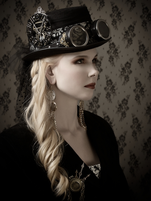 This is how I like to wear my goggles. I perch them on my hat. I usually wear a taller top hat than this equestrian riding hat, but I do wear many different hat style (I love hats) with several different styles of goggles.