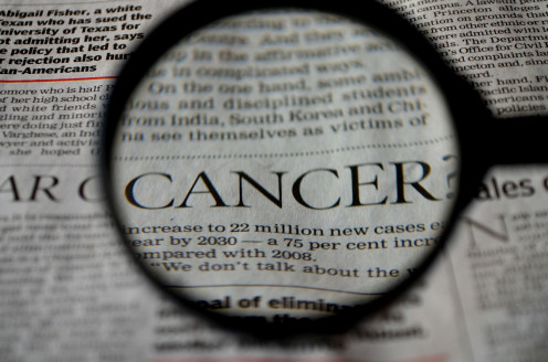 cancer newspaper word magnifier magnifying glass