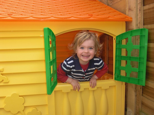 Child playing in playhouse