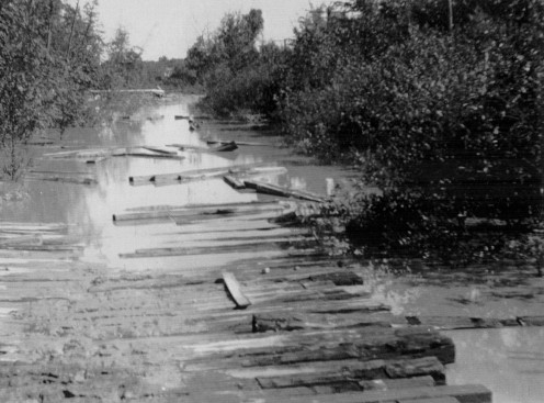 Old plank road in early Lansing.